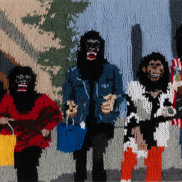 Kate Just Feminist Fan #16 (Guerrilla Girls in New York City by George Lang, 1995) 2015 hand-knitted wool and acrylic yarns, canvas, timber 60 x 40 cm Artbank Collection © the artist.