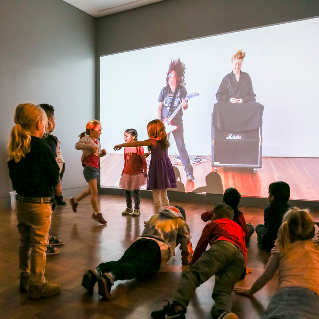 Children dancing to video work during a SAM Education program