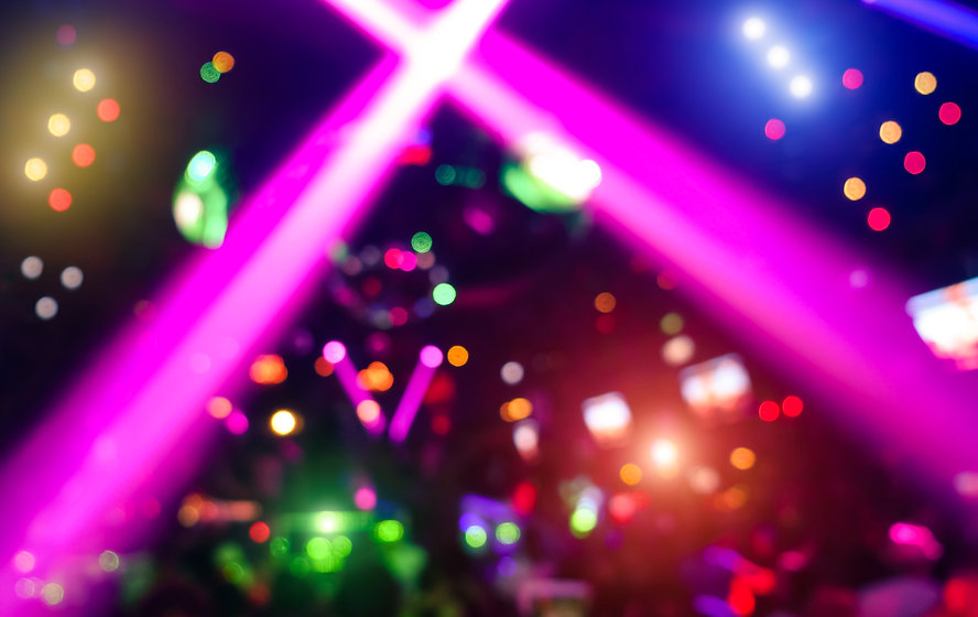 Abstract Background With Defocused Bokeh Of Laser Show In Modern Disco Party Night Club.jpg