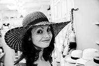 """Joie in a hat shop"" ~ Photo Copyright © Jon Vomhof ~ Author Joie Lesin"