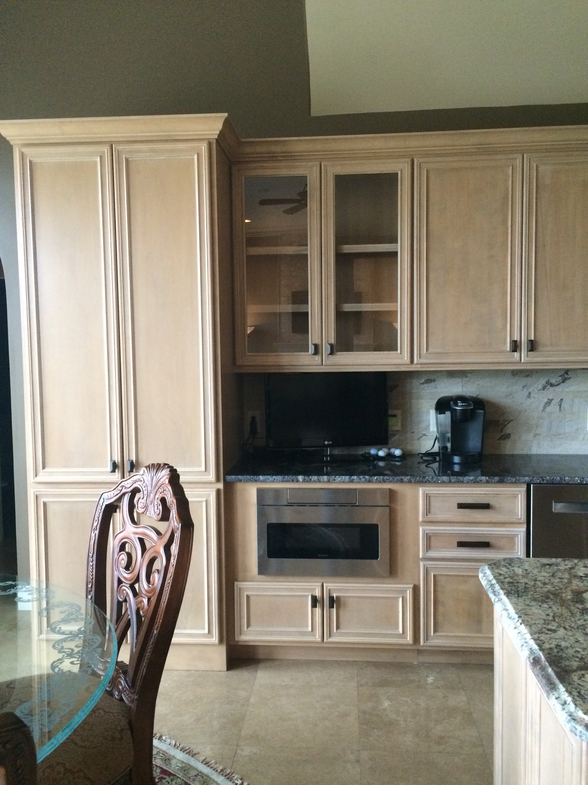 Detailed cabinetry and tile