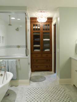 Shower and linen cabinet