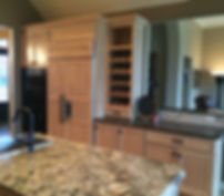 Opened up kitchen with wine rack