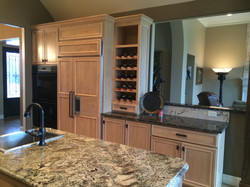 Built-in wine rack and clad fridge