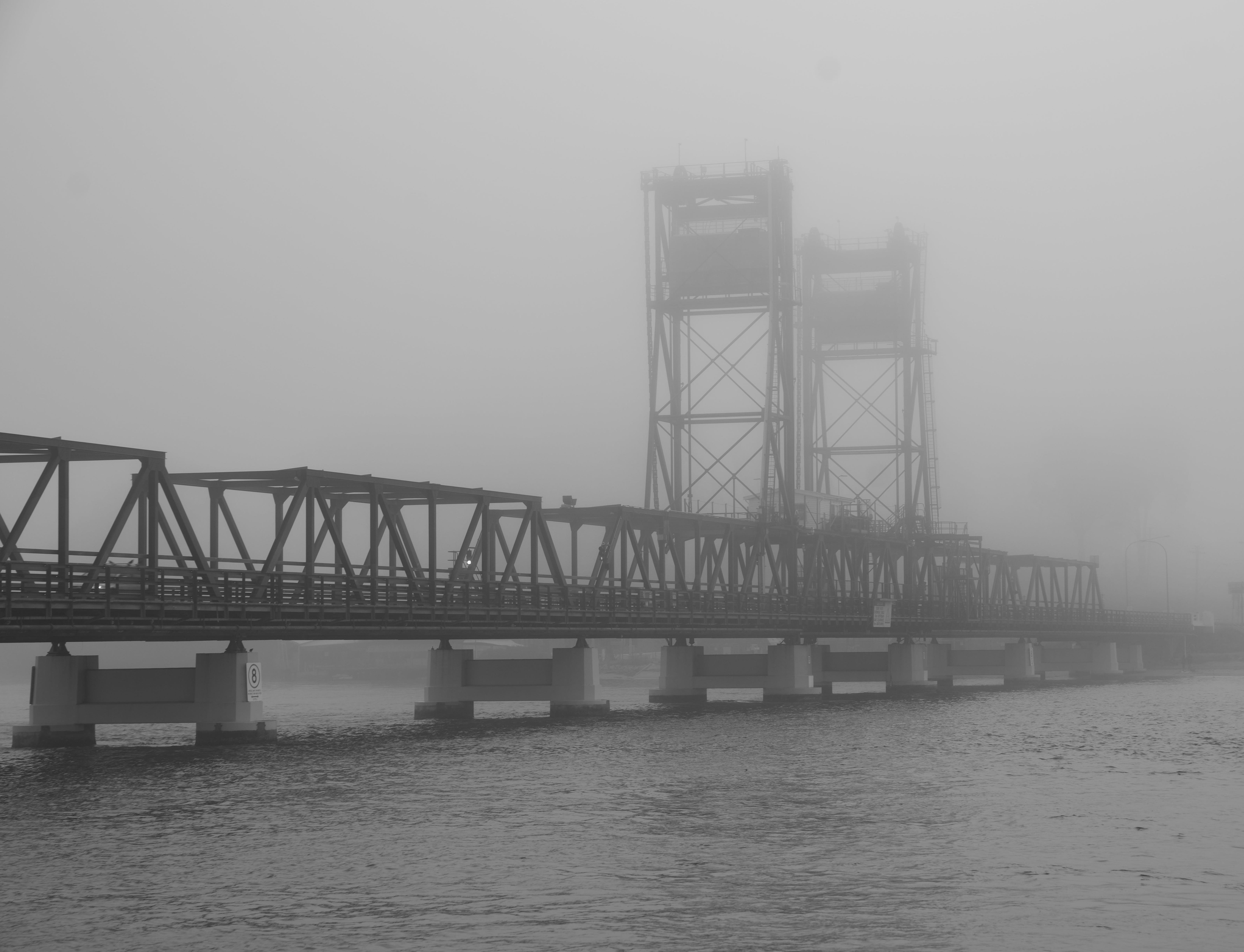 Bridge in the mist by Phil Warburton