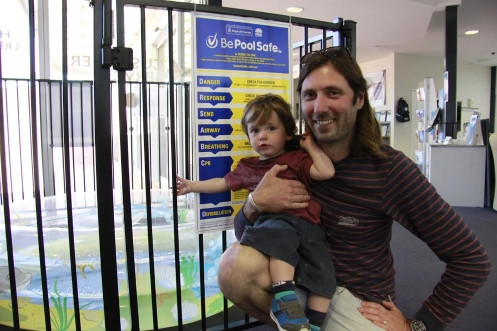 Patrick Brown, 16 months, checks out the pool safety display with his dad Beau at the Eurobodalla Shire Council administration building in Moruya.