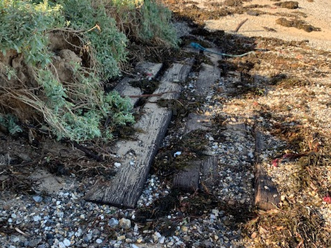 Remains of Long Beach boat ramp exposed by recent high seas