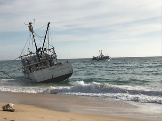 Fishing trawler run aground on Bermagui Beach