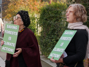 A peaceful assembly supports arrested Extinction Rebellion activists at Bega Court.