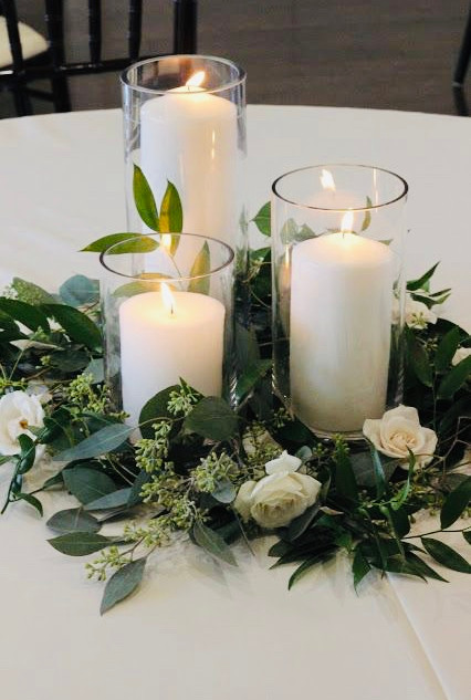 glass cylinder with pilar candles.jpg