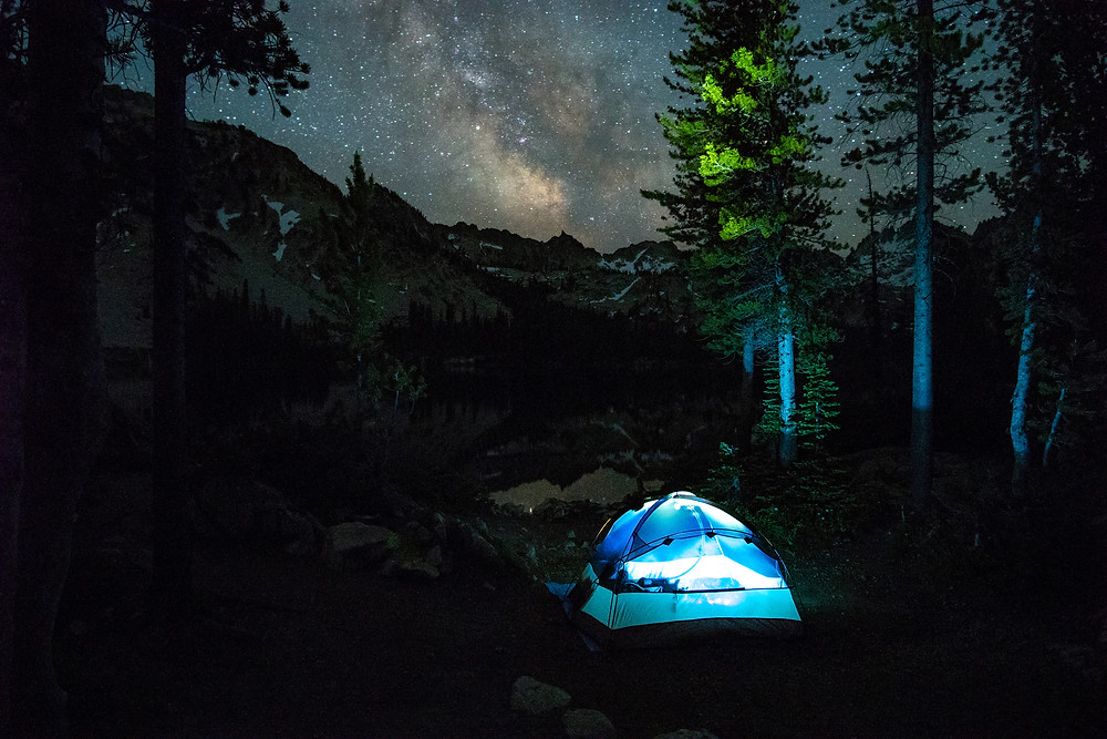 My tent illuminated beneath the Milky Way at Alice Lake