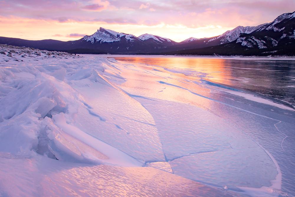 Sunrise over a frozen lake in Alberta, Canada