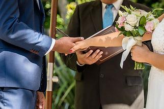 Man And Woman Exchanging Wedding Rings.j
