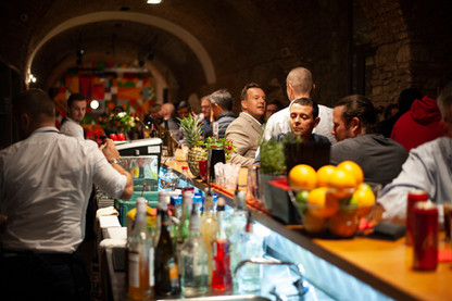 Guests line the bar during the grand opening of The Club, October 16, 2019