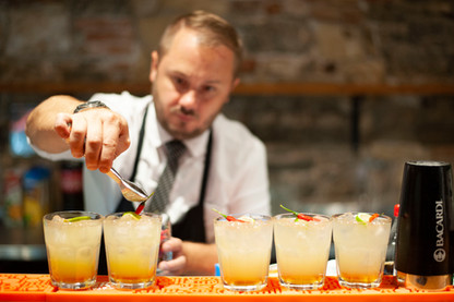 """Barman David Smolný adding the """"cherry"""" on top of the Salsita Cocktail during the grand opening"""