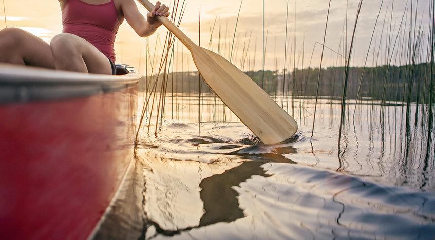 Woman canoeing at sunset on Jackfish Lake, Manitoba.jpg