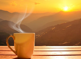 Morning cup of coffee with mountain back