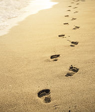 Footprints in the sand at sunset. Beauti
