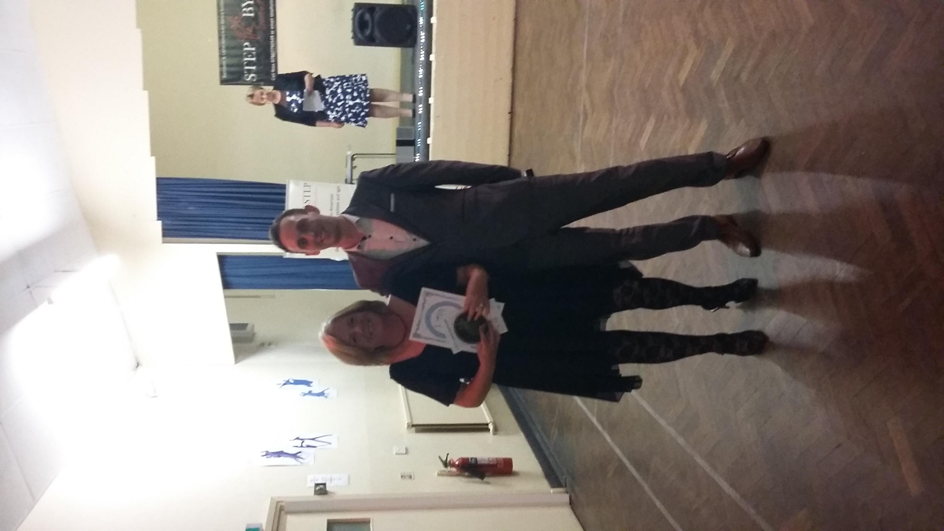 Angela receiving her Intro 6 award