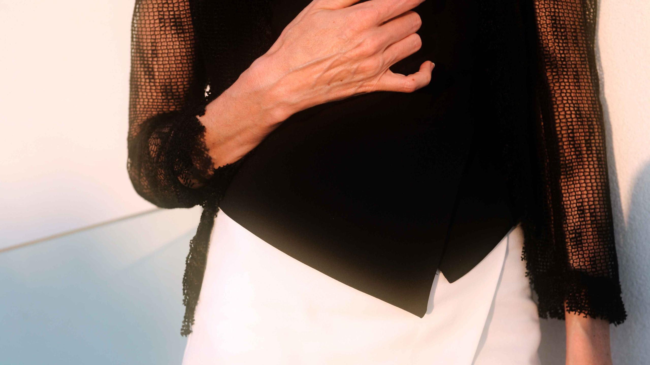 giacca a rete con maniche sfrangiate