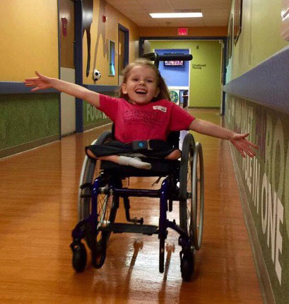 The photo is of Mikayla showing off her new and updated wheelchair up at St Louis Children's Hospital just this summer (2016).