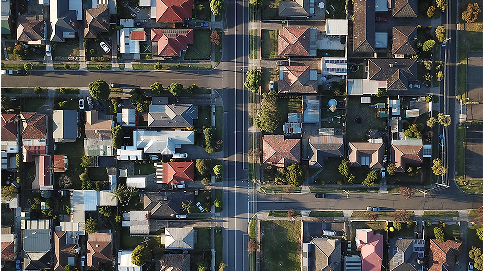 arial view of a suburban landscape shoing rooftops and streets