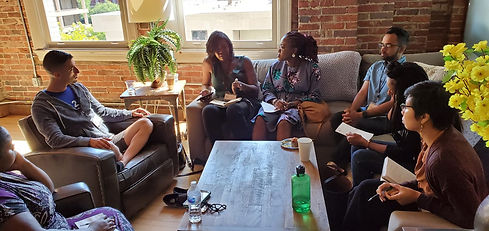 diverse group of people talking part of a community conversation