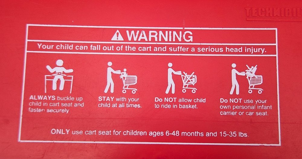 grocery cart warning label
