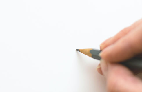 close-up-of-hand-holding-pencil-over-white-background-316466_edited.jpg