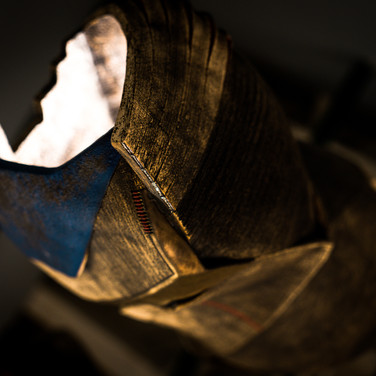 Taken from gallery Fried Benda, NYC. Viewed from a distorted angle of a bronze-glazed handifcrafted lamp.