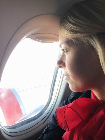 Looking out the plane window thinking