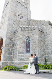 A couple, just married outside the church