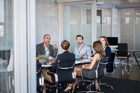 bigstock-Business-people-sitting-in-boa-