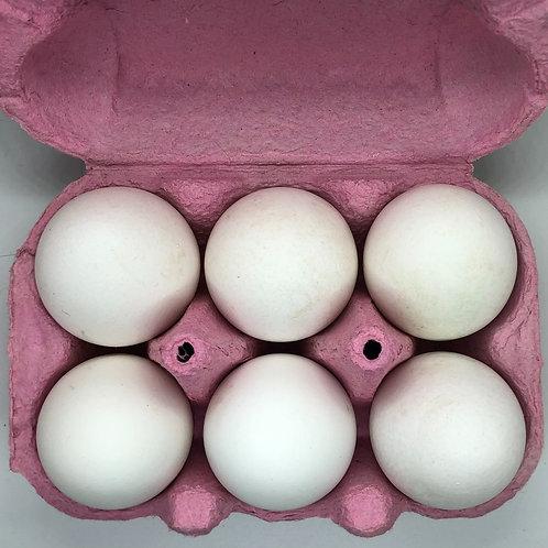 6 WHITE free range eggs.