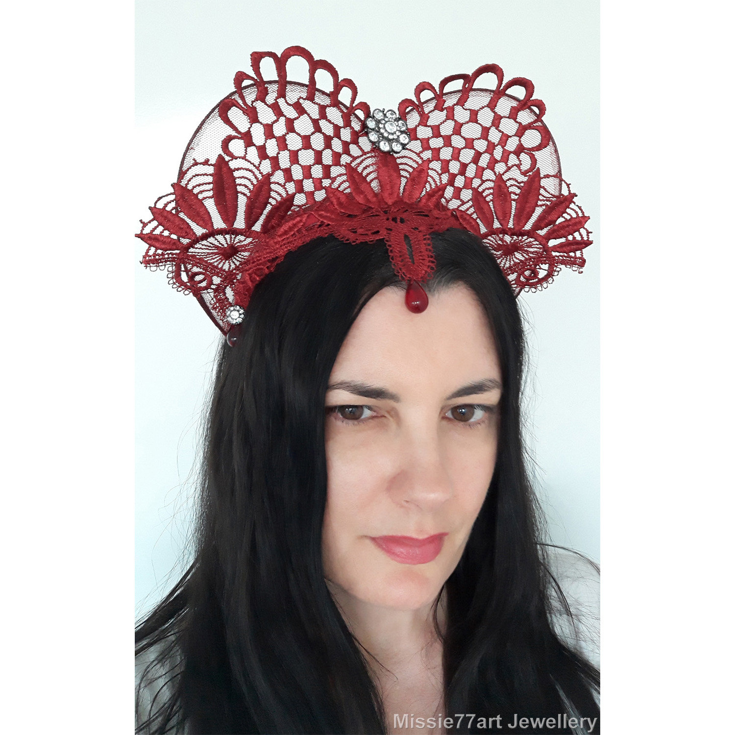 a8803d0db018 Perfect for the races, themed weddings and Burlesque; this burgundy red  headpiece features decorative floral lace ...