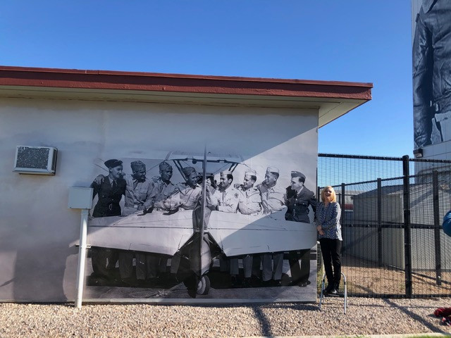 Descendant Anne Beeby stands by her father Ken Beeby (BFTS Class 11) on a wrap at Falcon Field.