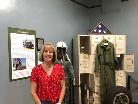 Jocelyn Condon at the Mesa Historical Museum Women in Aviation Exhibit. WOFF loaned artifacts to the museum for display.
