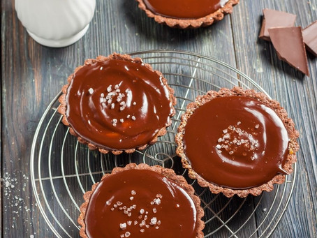 Mini Tarts of Salted Butterscotch Pudding with Coconut Porter Syrup and Smoked Whipped Cream