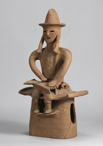Terracotta clay figure playing koto