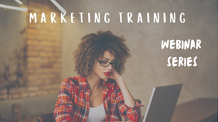 Woman sitting in a red check shirt looking at marketing training on a laptop