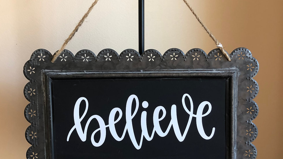 Believe tin sign