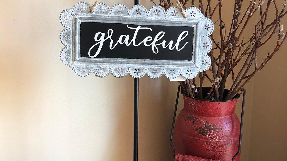 Grateful tin sign