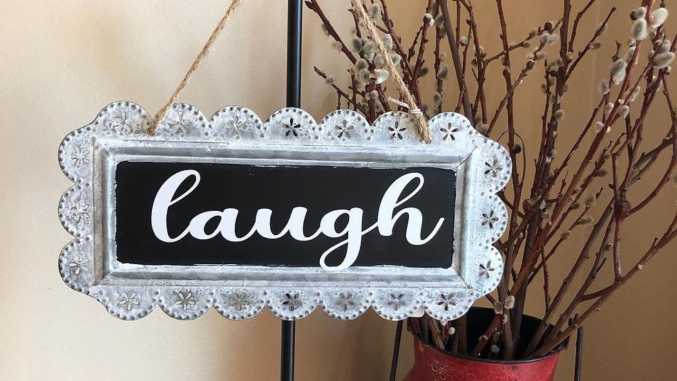 Laugh tin sign