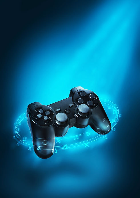 Video game controller and blue light. Playing games background. Creative art and design..j