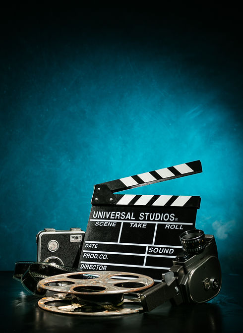 Vintage film claper with film reel and camera. filmmakers equipment background.jpg