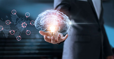 Businessman holding brain and light bul