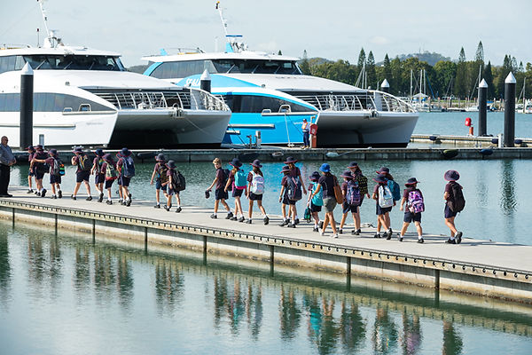 Caption: Local students boarding a Sealink's 'Capricorn Sunrise' to learn more about the Port of Gladstone.