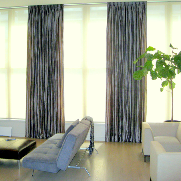 Pinch pleated floor to ceiling silk drap
