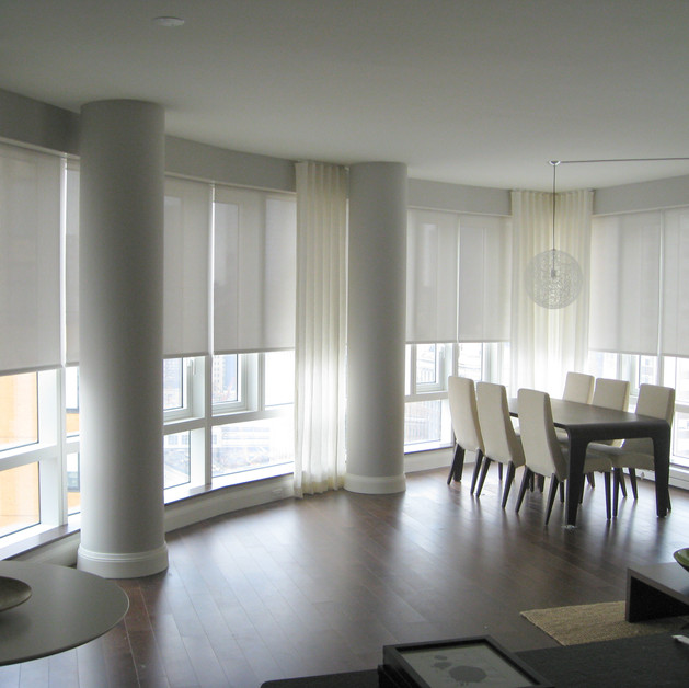 Solar shades and linen drapes in lower e