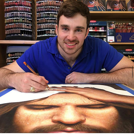 Artist drawing portrait with colored pencil